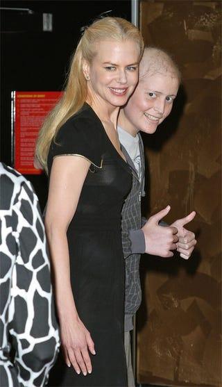 Illustration for article titled Nicole Kidman, Appreciative Escort Hit Charity Screening