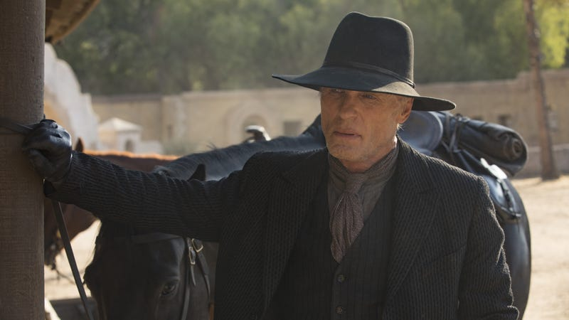 The elder William (Ed Harris) contemplates a hat change.