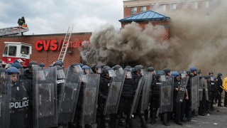 Police form a line in front of a CVS pharmacy that was burned during the protests in Baltimore April 27, 2015.Instagram