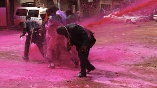 Illustration for article titled Ugandan Police Sprayed People with Pink Water Cannons to Break Up a Ceremony