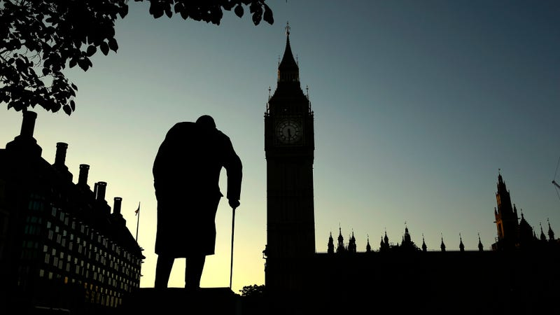 A statue of Winston Churchill is silhouetted against the Houses of Parliament and the early morning sky in London, Friday, June 24, 2016. (Associated Press)
