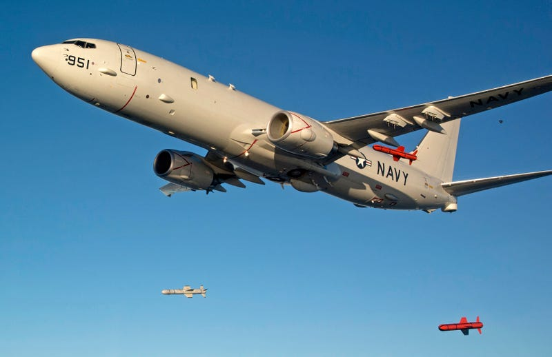 Illustration for article titled This Shot Of A P-8 Poseidon Dropping Three Harpoon Missiles Is Triumphant
