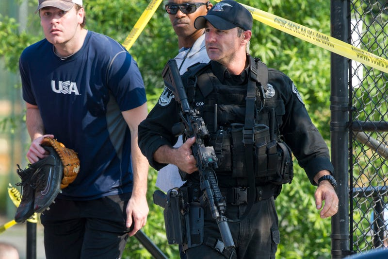 A member of the congressional Republican baseball team is allowed to leave the scene of a multiple shooting involving House Majority Whip Steve Scalise of Louisiana on June 14, 2017, in Alexandria, Va. (Cliff Owen/AP Images)