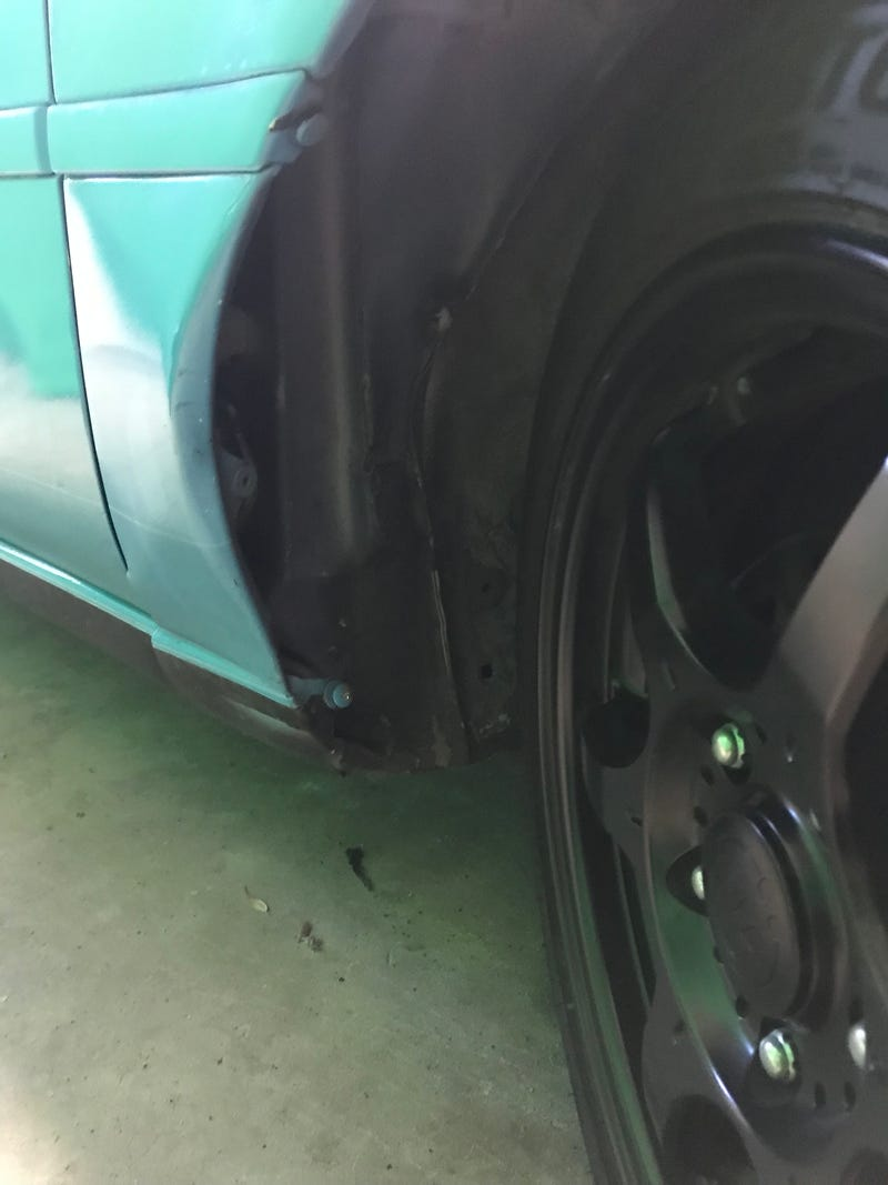 Illustration for article titled How does one affix a mudflap to a fender like this?