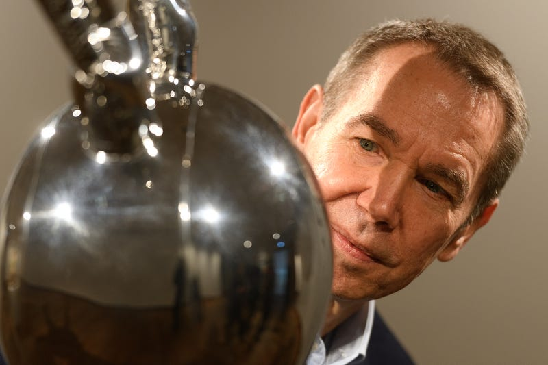 """Artist Jeff Koons looks towards """"Rabbit"""" for photographers during the press launch of an exhibitions of his work at the Ashmolean Museum on February 04, 2019 in Oxford, England."""