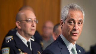 Interim Chicago Police Superintendent John Escalante (left) listens as Chicago Mayor Rahm Emanuel addresses changes in training and procedures that will take place at the Chicago Police Department in the wake of recent shootings on Dec. 30, 2015, in Chicago.Scott Olson/Getty Images
