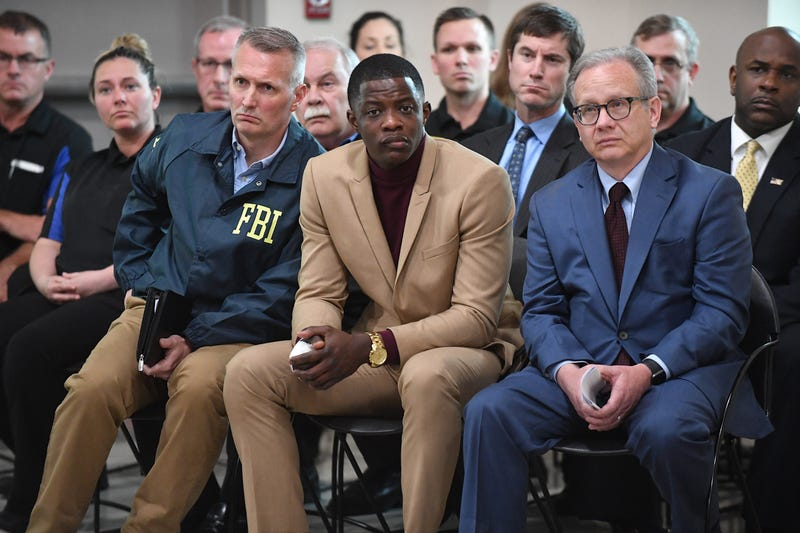 Waffle House patron James Shaw Jr. (center), who disarmed the gunman in the fatal mass shooting at a Tennessee Waffle House, appears at a press conference with FBI agents and Metro Nashville Mayor David Briley (right) April 22, 2018, in Nashville, Tenn.