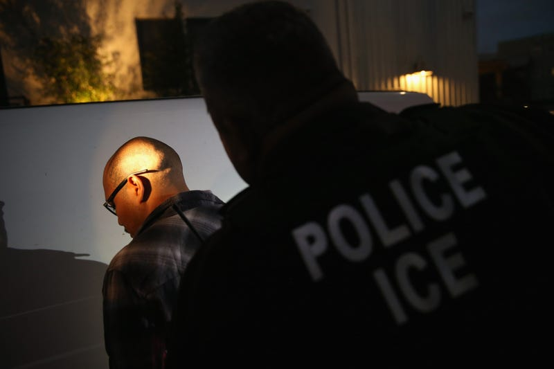 A man is detained by Immigration and Customs Enforcement agents Oct. 14, 2015, in Los Angeles.   (John Moore/Getty Images)