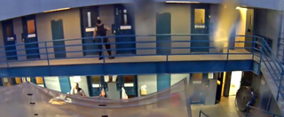 Screenshot showing a corrections officer looking into Cynthia Apkaw's cellFox10
