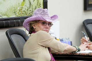 Illustration for article titled Yeah, Jane Fonda Gets A Manicure Wearing A Lavender Cowgirl Hat, So What?