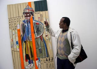 Fab 5 Freddy with a work by Basquiat (Getty Images)