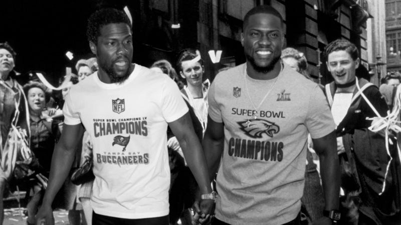 Illustration for article titled Cutest Celebrity Couple Ever! Kevin Hart And A Version Of Kevin Hart From 3 Years InThe Future Were Spotted Holding Hands On VE Day