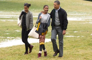 President Barack Obama and daughters Malia and Sasha cross the South Lawn of the White House after arriving by Marine One on Jan. 5, 2014, in Washington, D.C.Photo by Michael Reynolds-Pool/Getty Images
