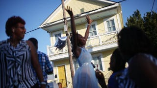 Revelers celebrate Aug. 23, 2015, during a second-line parade in New Orleans. The parades represent a history of solidarity, empowerment and cultural pride within the African-American enclaves of the city. The 10th anniversary of Hurricane Katrina, which killed more than 1,800 people and is considered the costliest natural disaster in U.S. history, is Aug. 29, 2015.Mario Tama/Getty Images