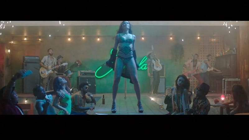 Illustration for article titled Freida Pinto Works the Pole as a Stripper in the New Bruno Mars Video