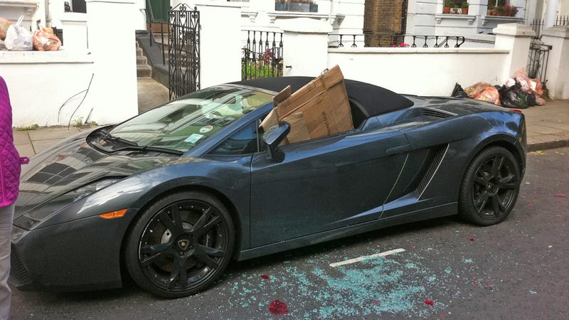 Illustration for article titled London rioters rough up a Lamborghini