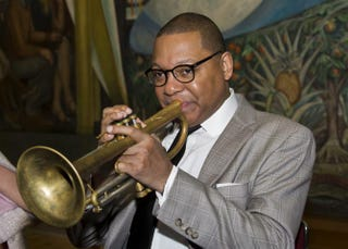 Trumpet player Wynton Marsalis poses for photographers playing a few notes prior to his press conference at the Fine Arts Museum in Mexico City on March 6, 2015. Marsallis will perform in Mexico on March 7 and 8. Photo by OMAR TORRES/AFP/Getty Images