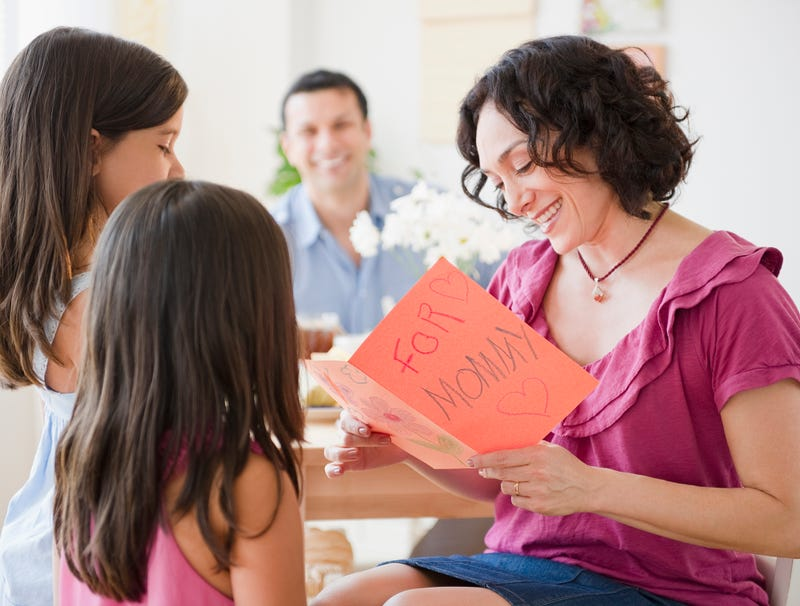 Illustration for article titled Woman Mentally Rearranging Rankings Of Children While Opening Mother's Day Gifts