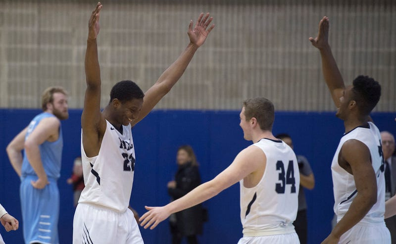 Yale's Justin Sears (left) and Thomas Ryan (center) celebrate the team's win against Columbia on Saturday. (Image via Associated Press/Bryan R. Smith)
