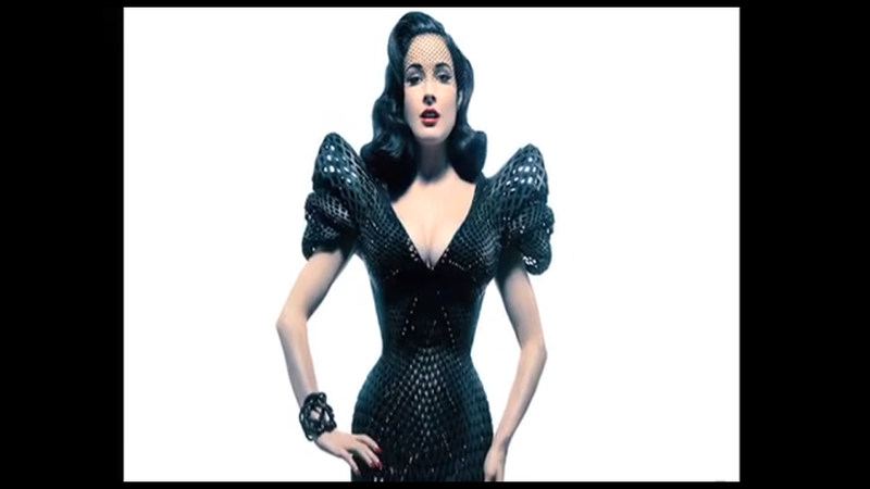 Illustration for article titled Dita Von Teese Models World's First 'Fully-Articulated' 3-D Printed Gown