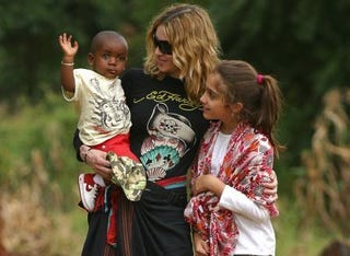 Madonna in Malawi with her daughter, Lourdes, and adopted son, David, in 2007.