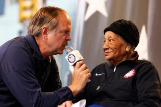 Sports broadcaster Jon Naber speaks to 1948 Olympic gold medalist Alice Coachman during the Team USA Road to London 100 Days Out Celebration in Times Square on April 18, 2012, in New York City.Jeff Zelevansky/Getty Images for USOC