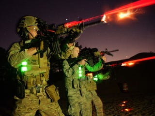 Illustration for article titled Airmen Throw Sparks And Glow In The Dark In Night Live Fire Training