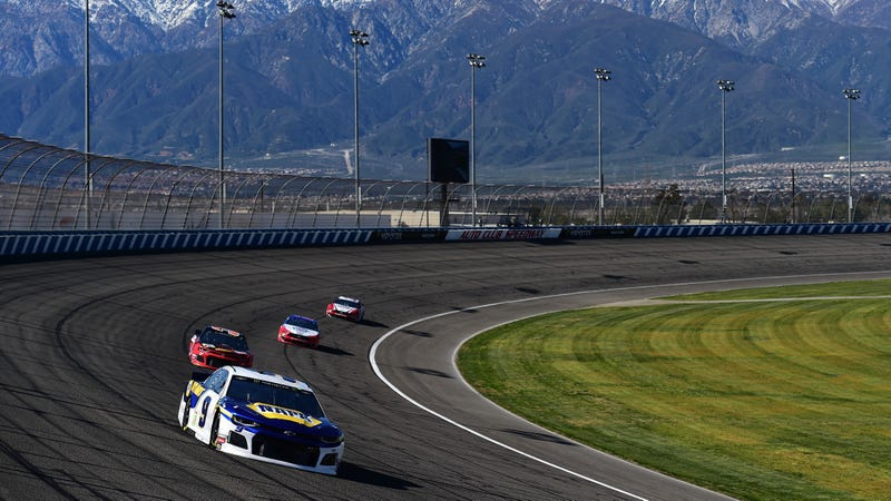 Chase Elliott ahead of a pack of cars during Monster Energy NASCAR Cup Series qualifying at Auto Club Speedway.