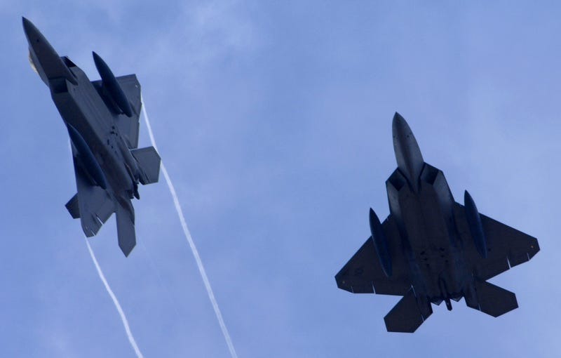 U.S. Air Force F-22 Raptors, built by Lockheed Martin Corp., fly above Andersen Air Force Base, Guam. Photo credit AP