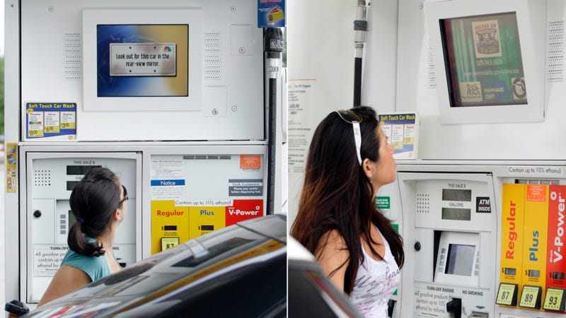 Two women no doubt wondering how to shut this infernal contraption up. Photos credit: Alan Diaz/AP Images