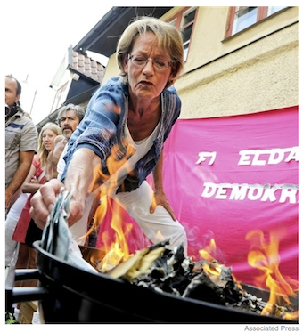 Illustration for article titled Swedish Feminists Burn Over $10,000 In Protest