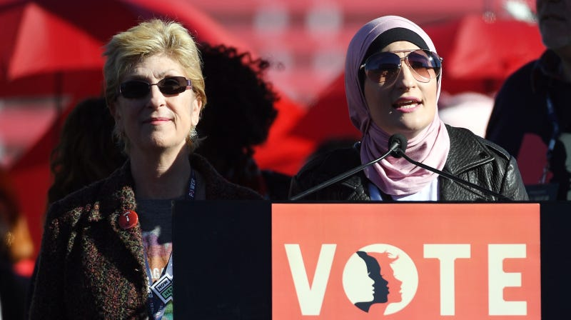 Clark County Commissioner and 2018 Nevada gubernatorial candidate Chris Giunchigliani (L) is introduced by Women's March Co-Chairwoman Linda Sarsour during the Women's March 'Power to the Polls' voter registration tour launch at Sam Boyd Stadium on January 21, 2018 in Las Vegas, Nevada.
