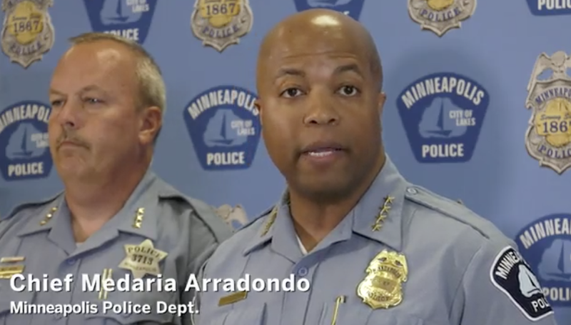 Minneapolis Police Chief Medaria Arradondo (right) speaks about ending the city's low-level marijuana stings.