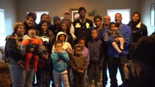 2 Chainz (center) and the family who received a free house for a yearFacebook