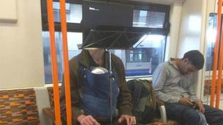 Illustration for article titled This Guy's Laptop-and-Music Stand Commute Set-Up Is Absurdly Wonderful