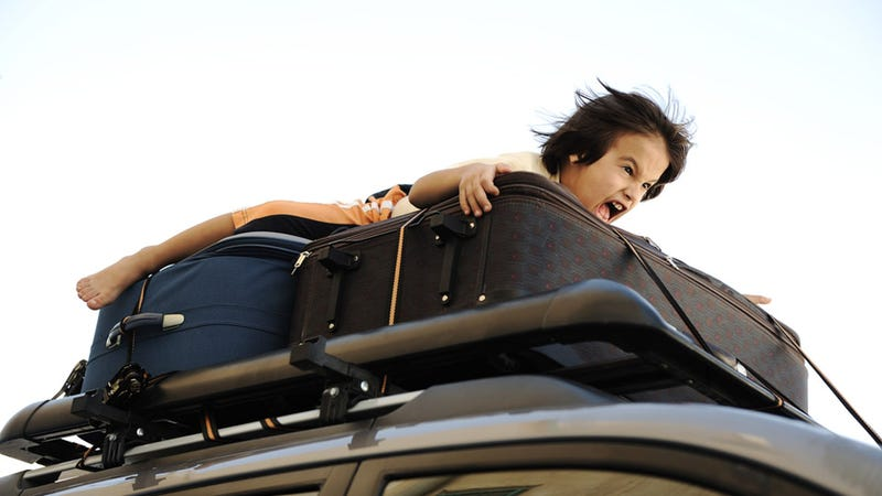 Illustration for article titled Horrible Parents Drive With Their Four Kids Strapped to the Car