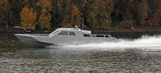 Illustration for article titled This Is the Navy SEAL's Shadowy New Multi-Mission Stealth Speedboat