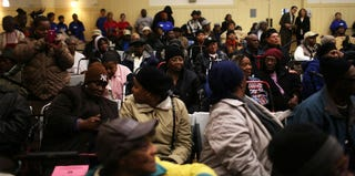 People wait for free Thanksgiving groceries at a community center in Harlem. (Spencer Platt/Getty Images)