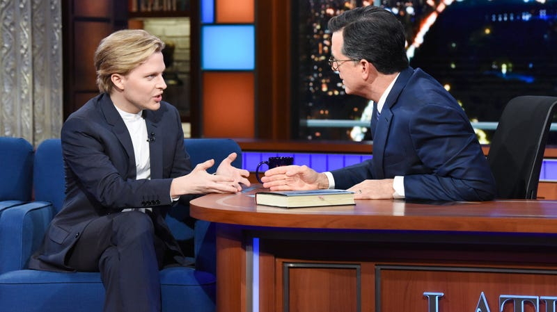 """Illustration for article titled Ronan Farrow tells Stephen Colbert he's seen the """"master list"""" of Trump dirt buried by the Enquirer"""