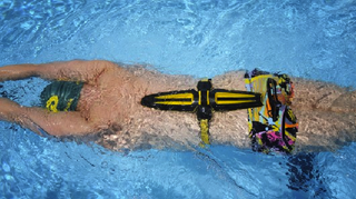 Illustration for article titled Corsuit Tool Trains Swimmers' Core Muscles Like a Full Body Suit