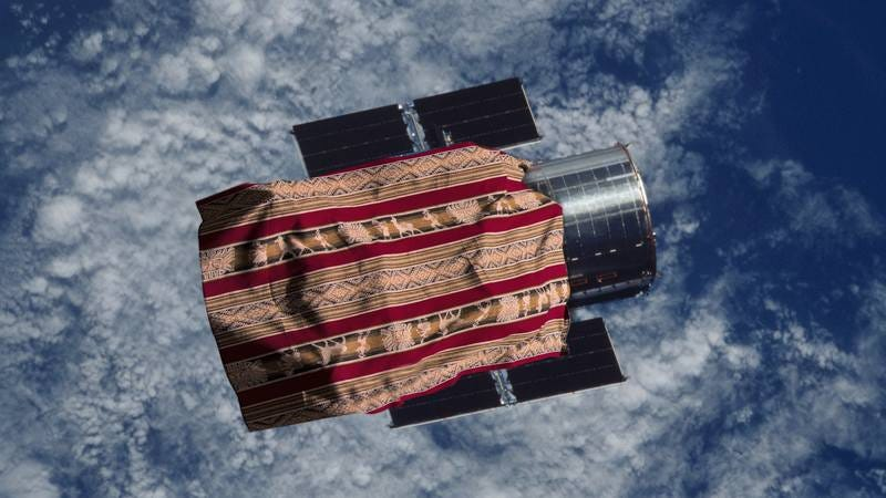 The Hubble Telescope with a blanket covering it.
