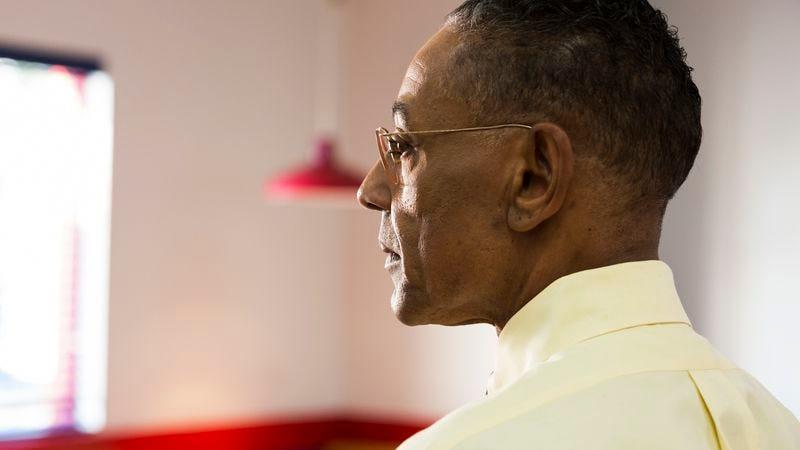 Gus Fring closeup in profile inside Los Pollos Hermando
