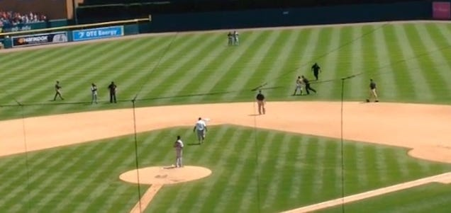 Idiot On the Field Evades One Security Guard, Gets Planted By A…