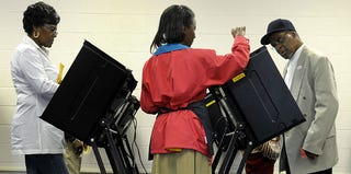 Voters in North Carolina get instructions during early voting in October 2012. (Sara D. Davis/Getty Images)
