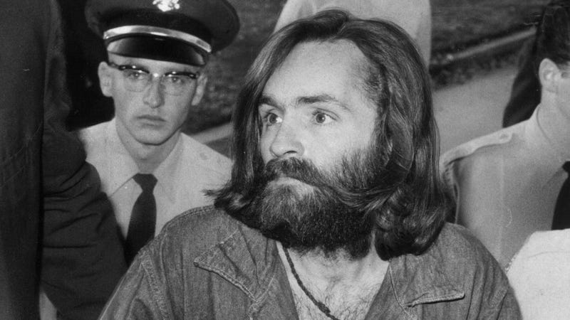Charles Manson being escorted to court for a preliminary hearing on Dec. 3, 1969, in Los Angeles. (John Malmin/Getty Images)