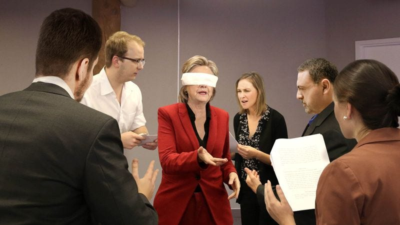 Illustration for article titled Blindfolded Clinton Invites Debate Coaches To Attack Her With Talking Points From All Sides