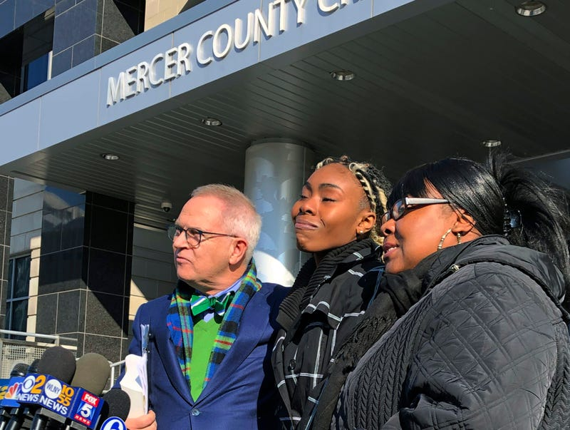 In this Dec. 12, 2018, file photo, Jazmine Headley, center, joins attorney Brian Neary and her mother, Jacqueline Jenkins, outside a courthouse in Trenton, N.J.