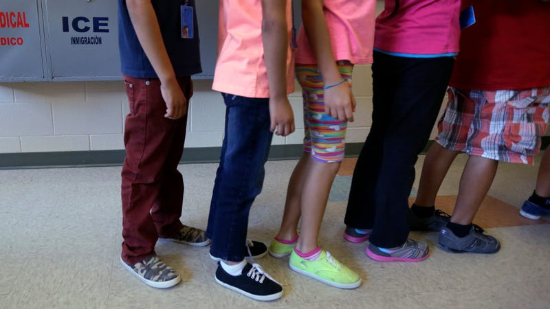 Children line up in the cafeteria at a detention facility in Karnes County, Texas