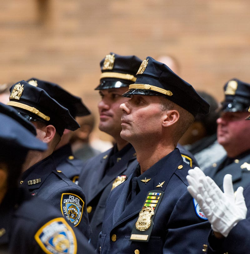 Kenneth Boss is seen as he gets promoted to the New York City Police Department rank of sergeant Dec. 17, 2015, at NYPD headquarters 17 years after he took part in the fatal shooting of the unarmed Amadou Diallo.Howard Simmons/New York Daily News via Getty Images