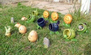 Illustration for article titled File Plants Vs. Zombies Lawn Ornaments Under 'Future ThinkGeek Product'